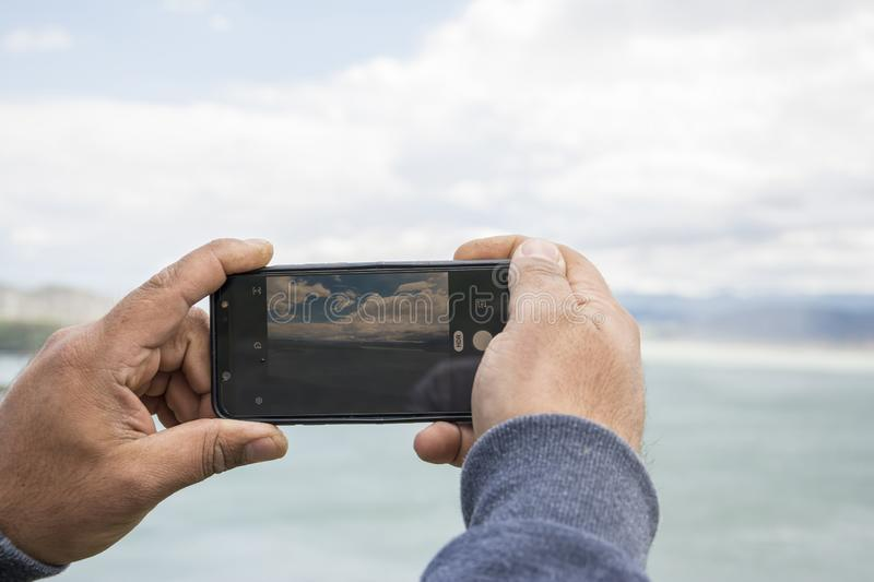 Close up of smartphone camera screen photographing beautiful landscape royalty free stock images