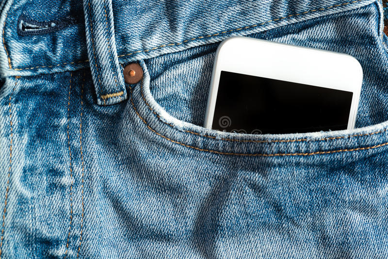 Close up of smartphone in front pocket on pants. Close up of smartphone in front pocket on blue pants stock images