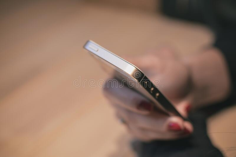 Close up of smartphone in hand stock images