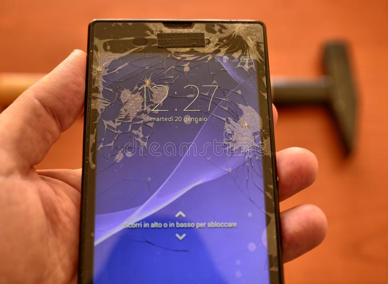 Close up on a smartphone screen with a broken screen stock image