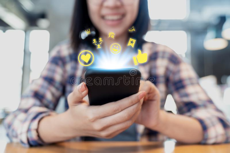 Close up smartphone social media network sharing and commenting in online community. Influencer woman`s hand holding mobile phone stock photo