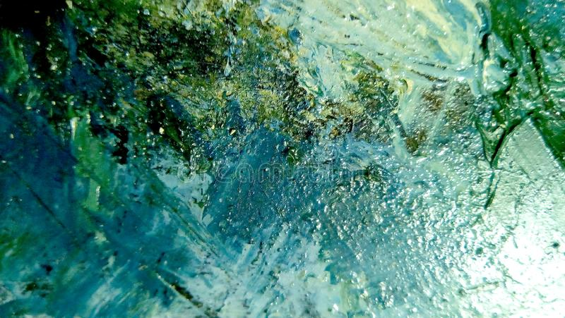 Close-up of smears of oil paint on the surface of the canvas. royalty free stock image