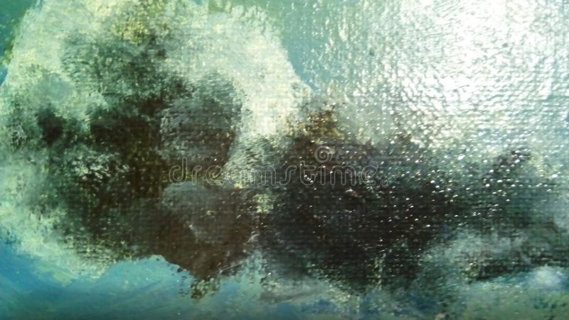 Close-up of smears of oil paint on the surface of the canvas. royalty free stock photo