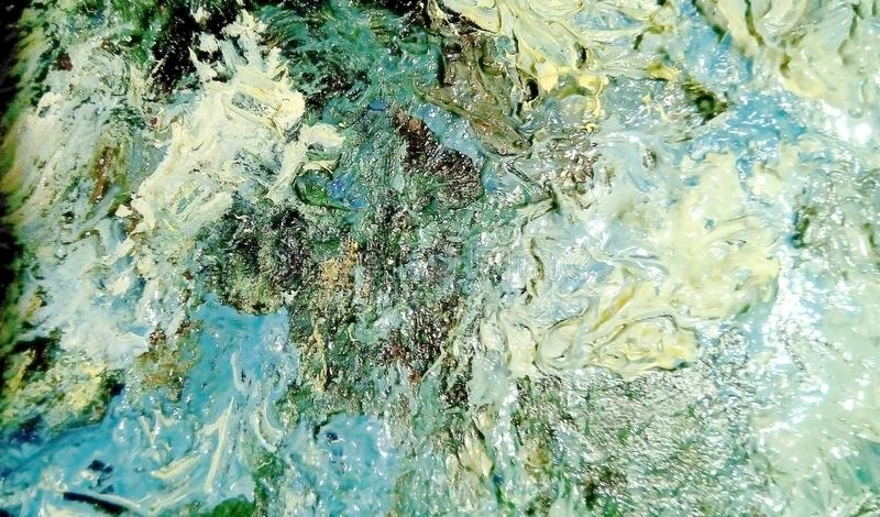 Close-up of smears of oil paint on the surface of the canvas. stock photos