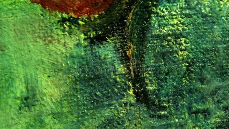 Close-up of smears of oil paint on the surface of the canvas. Green, yellow, buffy spots. stock photography