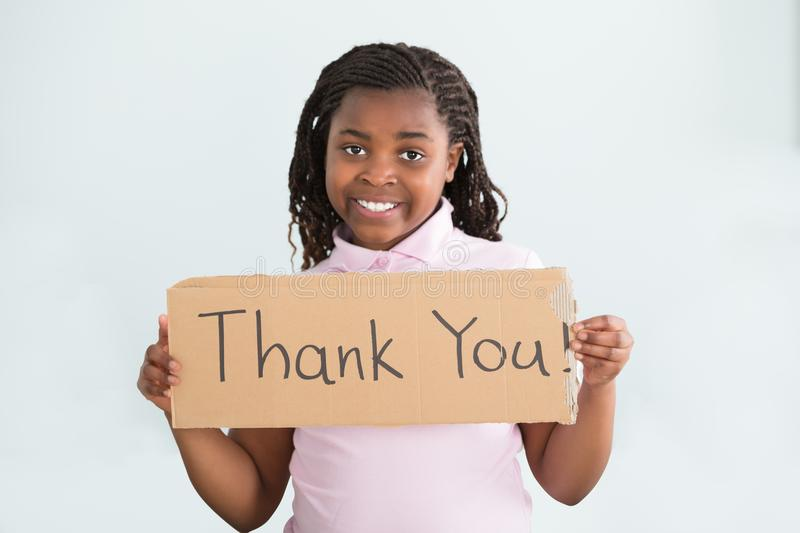 Girl Holding Thank You Sign royalty free stock photos