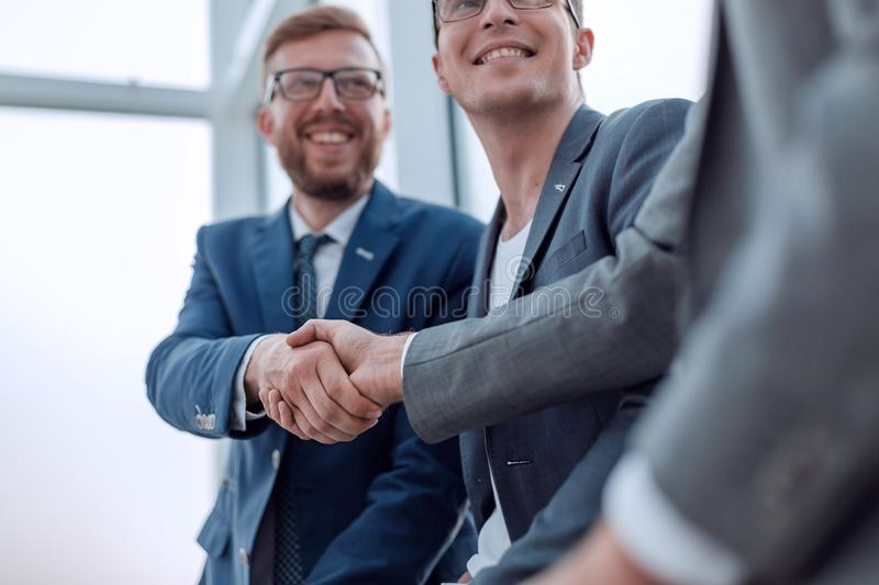 Close up. smiling business colleagues shaking hands stock photos