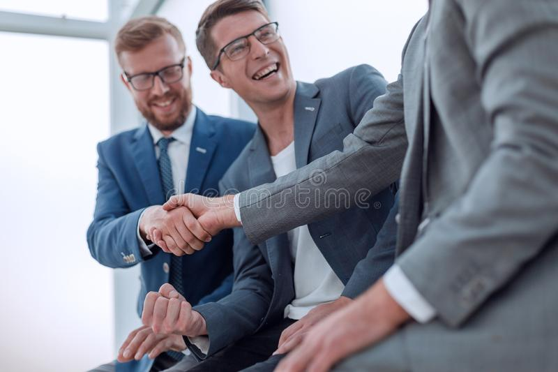 Close up. smiling business colleagues shaking hands stock photography