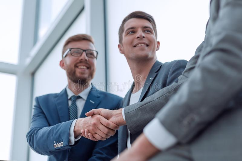 Close up. smiling business colleagues shaking hands royalty free stock images