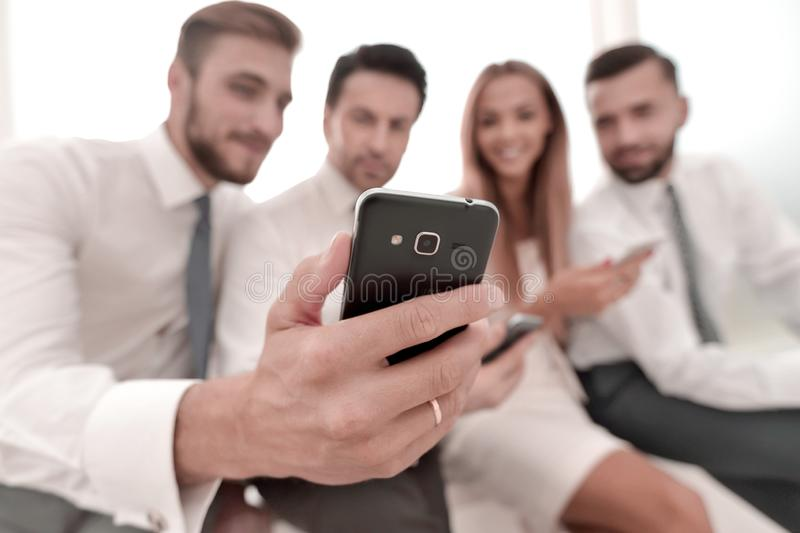 Close up.smiling business team discussing SMS stock images
