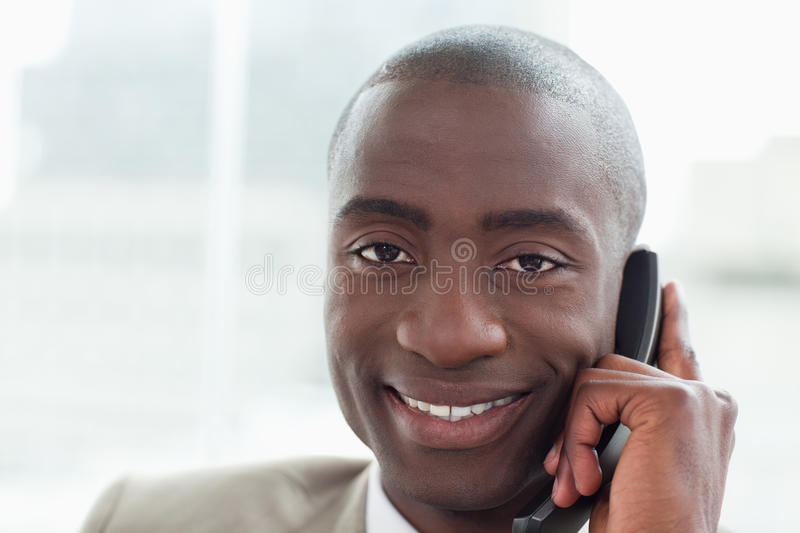 Download Close Up Of A Smiling Businessman On The Phone Stock Image - Image: 22693289