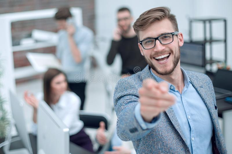 Close up. smiling businessman pointing finger at you royalty free stock photography