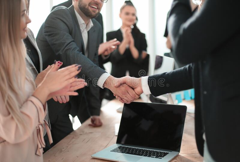Smiling businessman shaking hands with his business partner. royalty free stock image