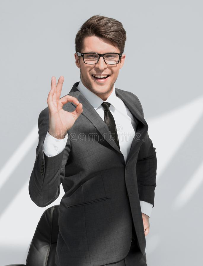 Close up.smiling businessman showing OK gesture royalty free stock image