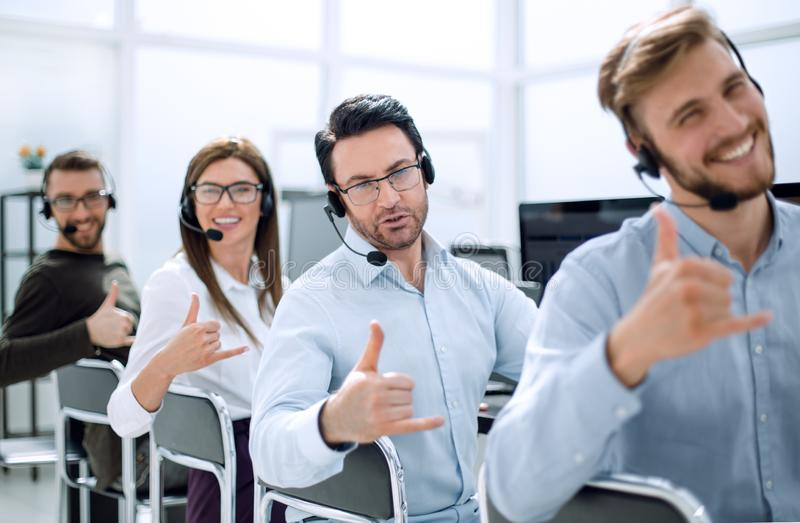 Close up.smiling call center staff showing thumb up stock images