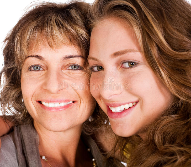 Close-up of smiling elder mum and daughter stock images