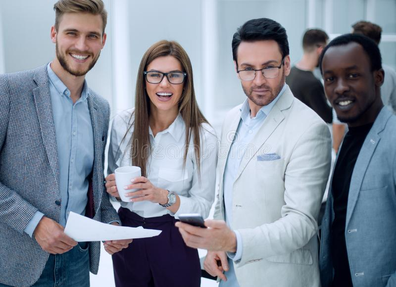 Close up.smiling employees standing in the office royalty free stock photography