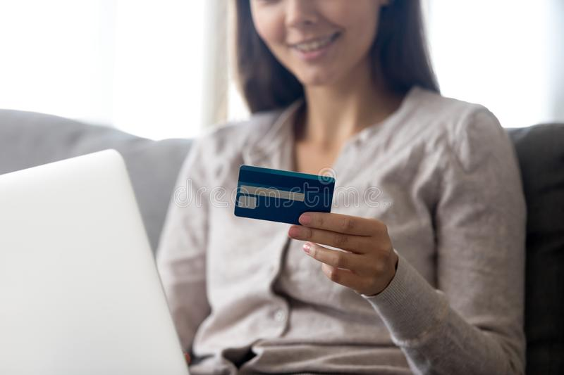 Close up of smiling girl hold credit card shopping online stock photography