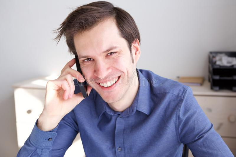 Close up smiling man in home office on business call. Close up portrait of smiling man in home office on business call royalty free stock photos