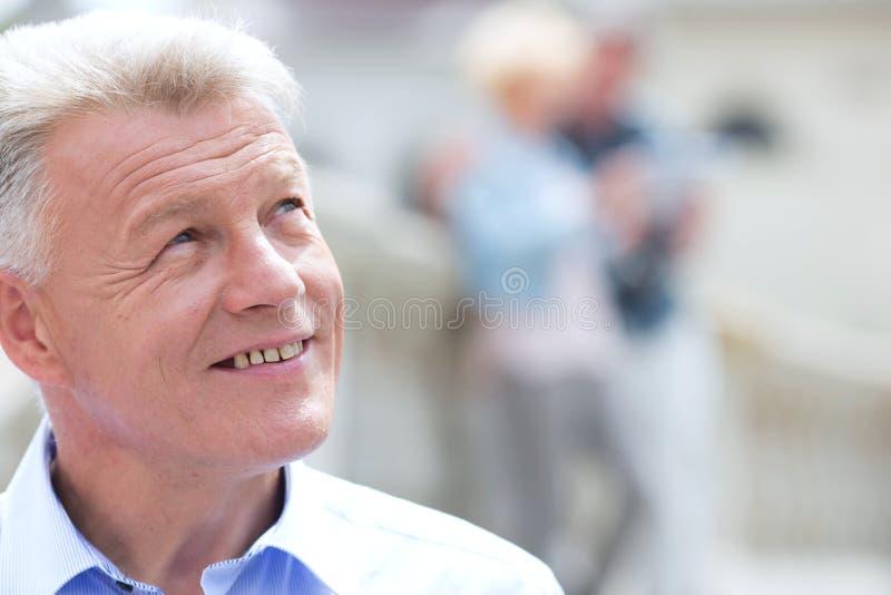 Close-up of smiling man looking away outdoors stock photos