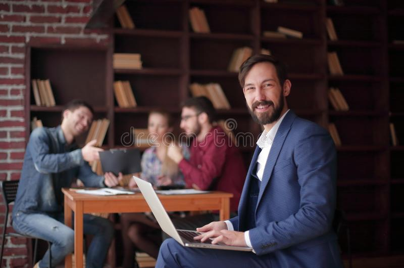 Close up.smiling Manager works on laptop. business concept royalty free stock photos