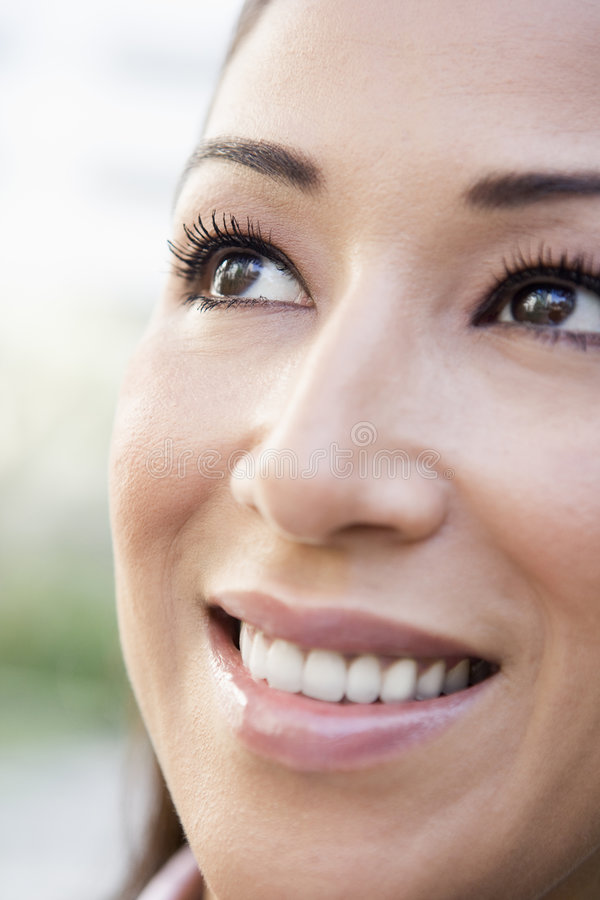 Close up of smiling woman. Smilling off camera stock image