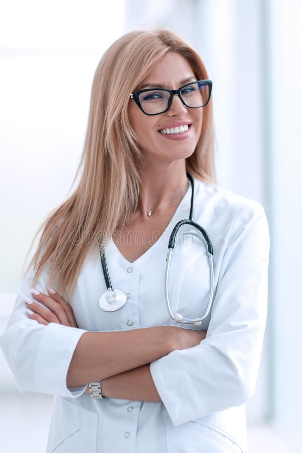 Close up. smiling woman doctor with stethoscope . stock photo