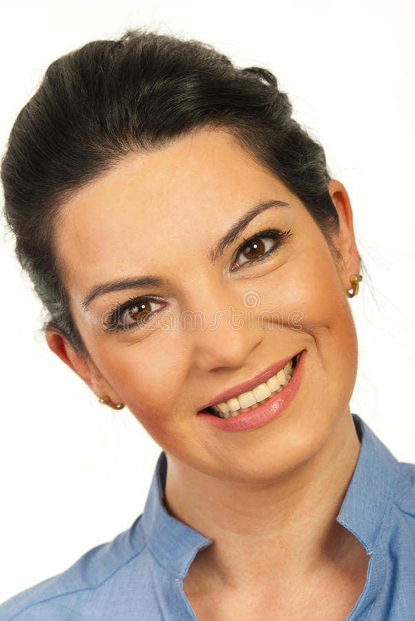 Close up of smiling woman face. Standing with head slightly bent to one side isolated on white background stock photos