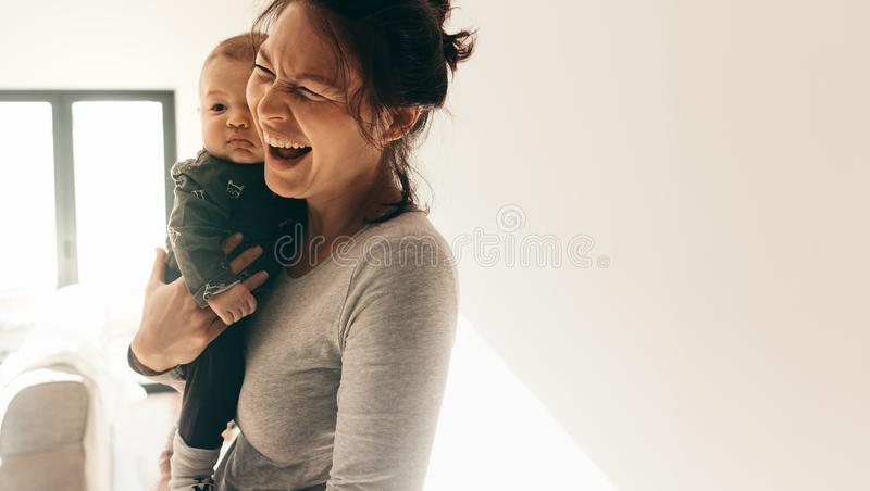 Portrait of a woman with her baby royalty free stock photography