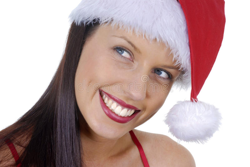 Close up of smiling young adult woman with red Christmas Santa hat isolated on white background royalty free stock images