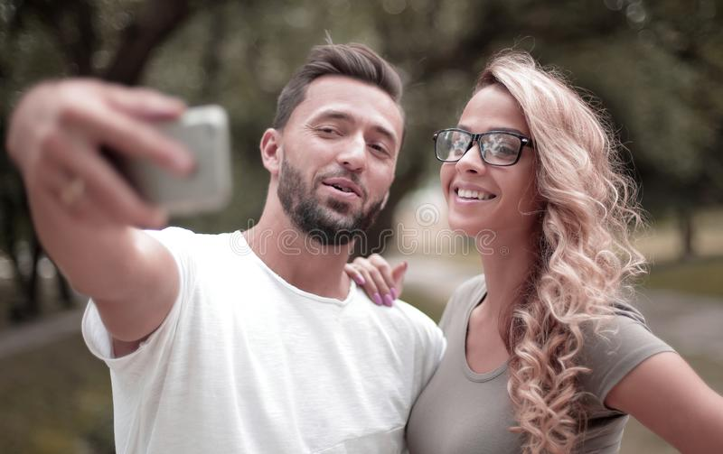 Close up.smiling young couple taking selfie in city Park stock image