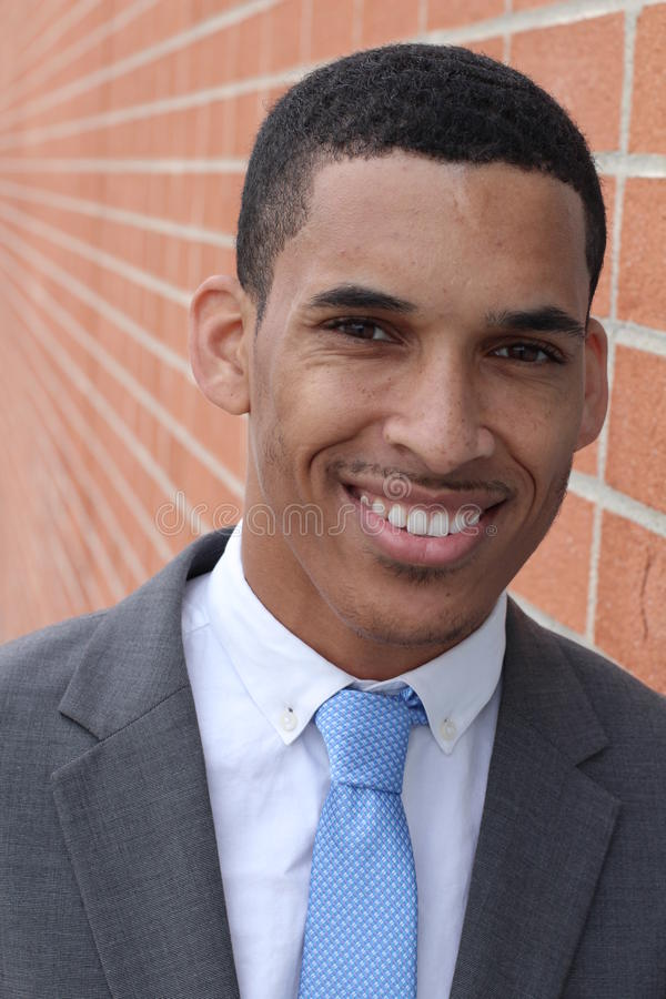 Close-up of smiling young, dark-skinned businessman stock images