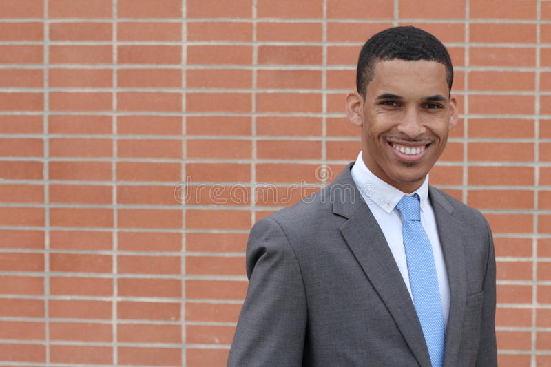 Close-up of smiling young, dark-skinned businessman with copy space stock photography