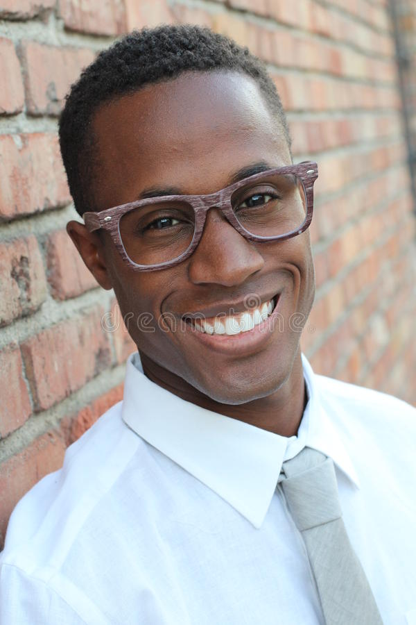 Close-up of smiling young, dark-skinned businessman with modern glasses royalty free stock images
