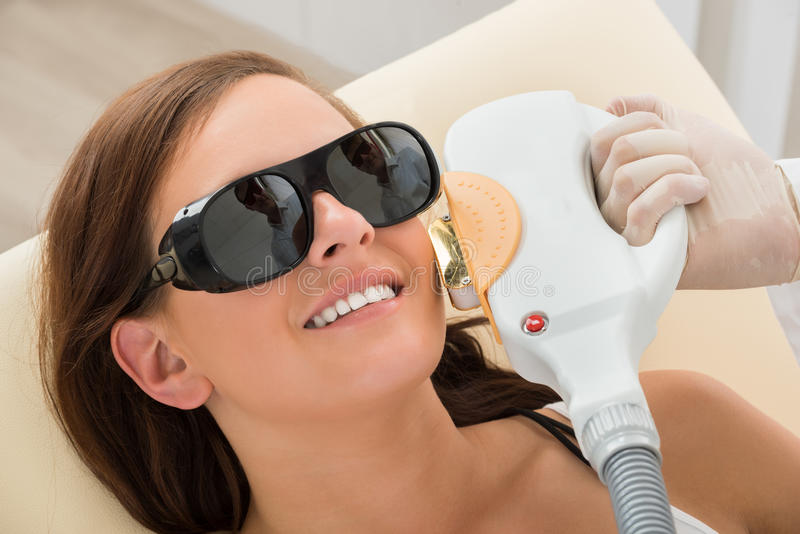 Woman Receiving Laser Hair Removal Treatment On Her Face royalty free stock photo