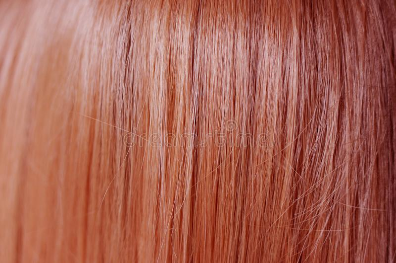 Close up of smooth and straight ginger red hair color stock photography