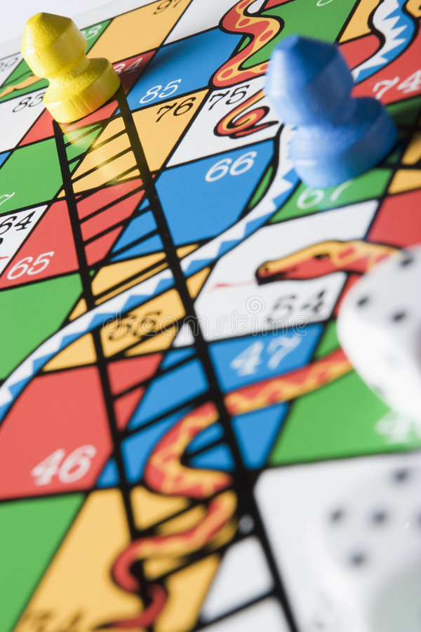 Close -Up Of Snakes And Ladders Board stock images