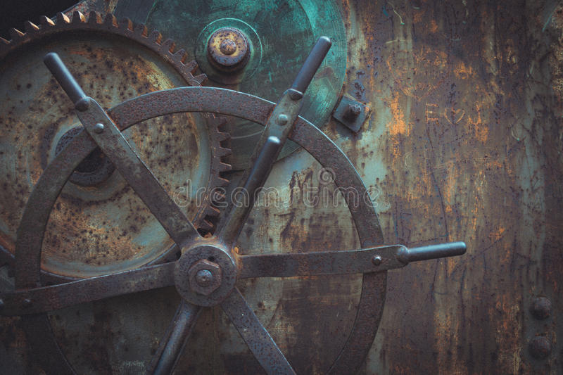 Close-up snapshot of ancient gears mechanism, Steampunk background. Vintage tinted snapshot of ancient gears mechanism. Steampunk background. Rusty metal wheel stock photo