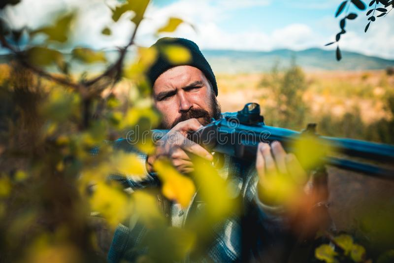 Close up snipers carbine at the outdoor hunting. Man holding shotgun. Hunter with shotgun gun on hunt. Deer hunt. Close up snipers carbine at the outdoor stock photography