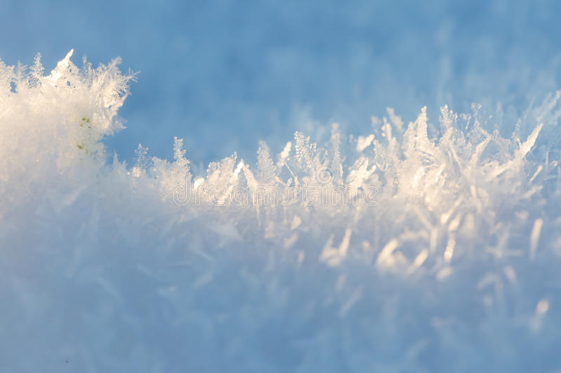 Close up of snow crystals stock image