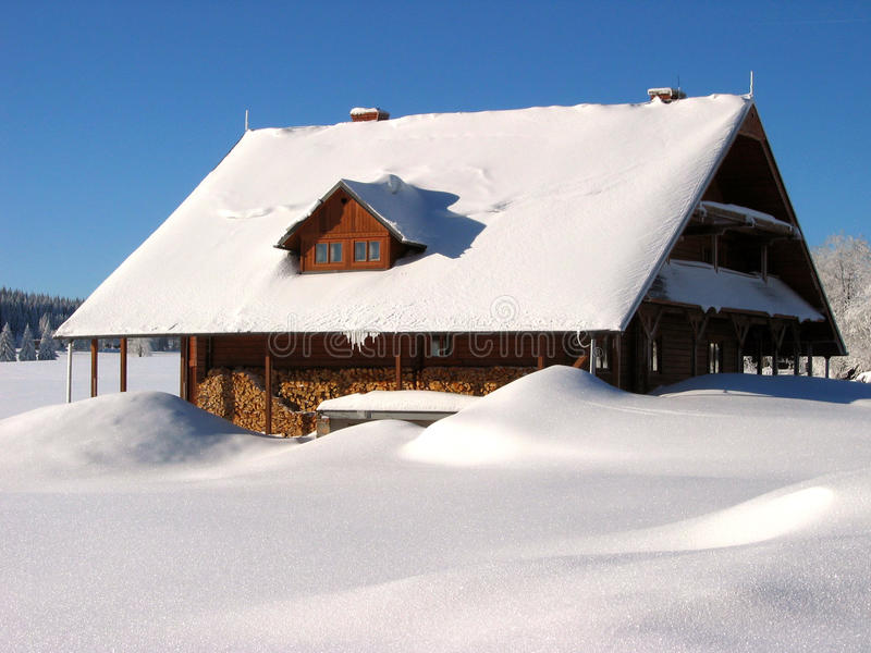 Close-up of snowed house in the mountains stock photo