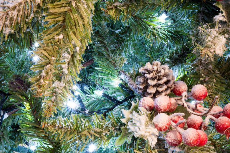 Download Close Up Of Snowy Christmas Tree With Decoration Stock Image