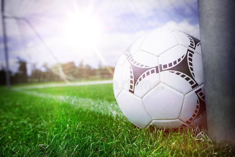 Close-up of soccer ball near a goal post stock photo