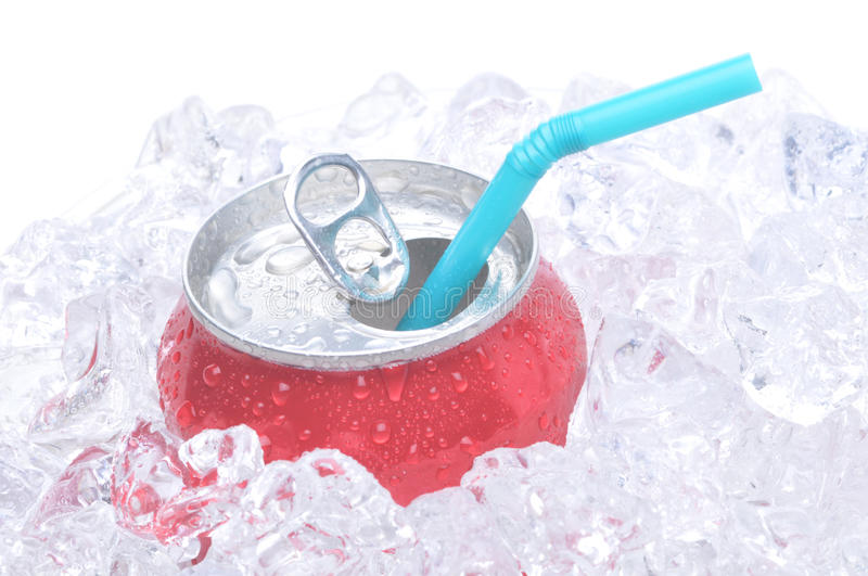 Close Up of Soda Can. Single soda can in ice with drinking straw white background copy space royalty free stock photos