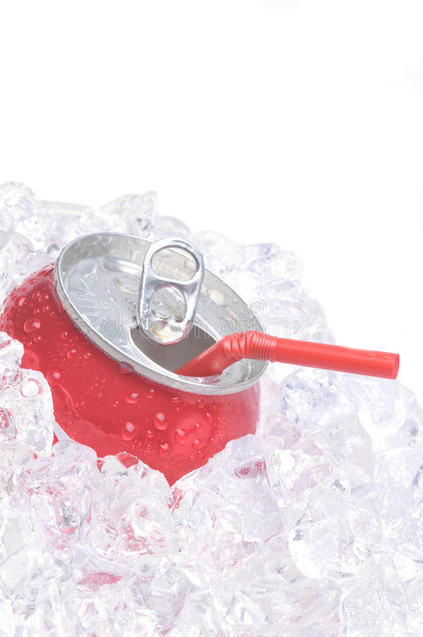 Close Up of Soda Can in Ice with straw. Close Up of Red Soda Can in Ice with Drinking Straw isolated on white royalty free stock images