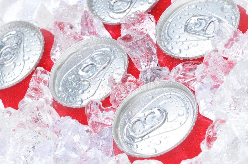 Close Up of Soda Cans in Ice stock photo