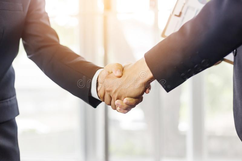Close Up of soft focus two young business man hands people shaking hands, finishing up a meeting Greeting Deal Concept royalty free stock photo