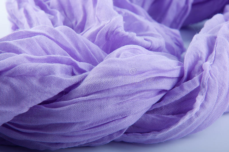 Close up of soft purple wrinkled fabric on white background stock photography