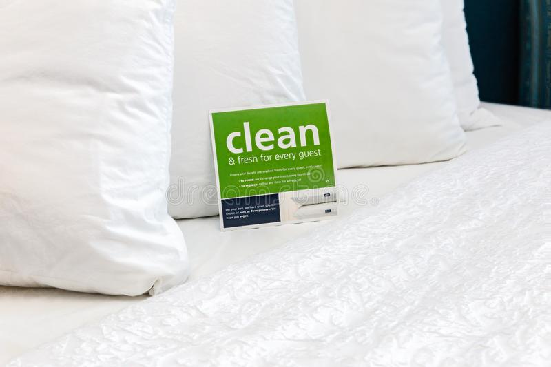 Close up of soft white fluffy pillows on bed. stock images