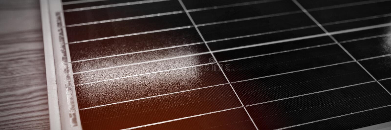 Solar panel on wooden table in office royalty free stock images